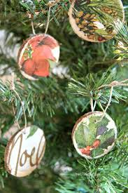 how to make decoupage ornaments with wood rounds and napkins the