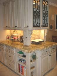 custom kitchen cabinets with glass doors custom built cabinets painted with highlights faux iron