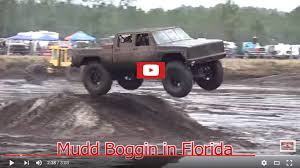 monster trucks in the mud videos the muddy news king max gets twisted up at the mud bog