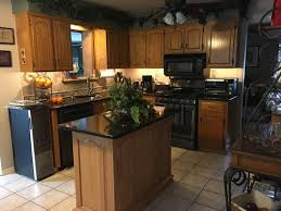 how to freshen up stained kitchen cabinets looking for remodel ideas to freshen up my kitchen on a budget