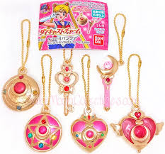 the two compacts on the left and the top right moon stick want