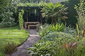 Grape Vine Pergola by Gap Gardens Indian Stone Path Leading Past Tropical Style Flower