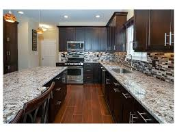 Kitchen Paneling Backsplash White Subway Tile Backsplash Shaker Cabinets Brass Hardware Dark