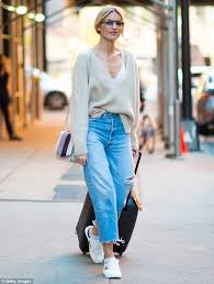 casual with martha hunt displays cleavage in a low cut sweater in nyc daily