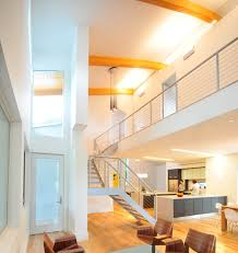 high ceiling and hanging minimalist lamp usual house staircase