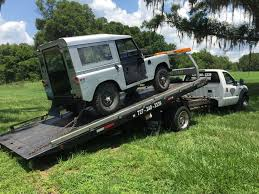car stuck and need a flat bed towing truck near me allways towing