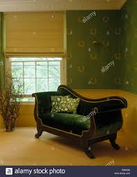 linen blind on window in country bedroom with french style green