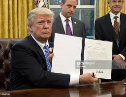 president trump signs executive orders in the oval office photos