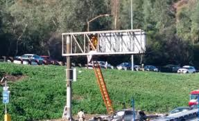 man lands on freeway sign after being ejected from vehicle in