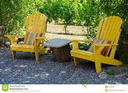 yellow adirondack chairs on a patio royalty free stock photo