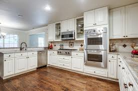 off white kitchen cabinets with white appliances basement