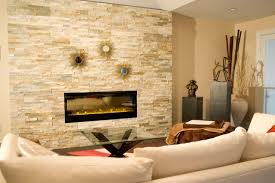 interior stacked stones fireplace mantels along with wood shelf