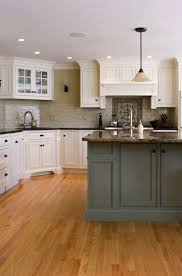 62 best cottage style kitchens images on pinterest cottage style three strong trends for 2013 come together in this transitional kitchen with white shaker style cabinets and gray tones in the countertops and island