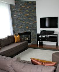 all wall long stacked stone corner fireplace