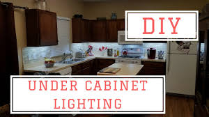 how to add lights kitchen cabinets installing diy cabinet lights for 75