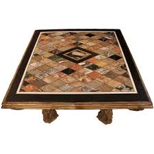 italian coffee table with a mecca carved base and a specimen