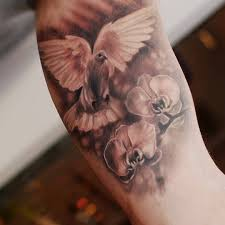 dove and cross tattoo 70 best dove tattoos ideas and designs with meaning