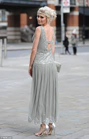 chloe sims wears a flapper inspired dress to a great gatsby themed