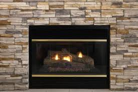 Inexpensive Electric Fireplace by Electric Vs Gas Vs Wood Fireplaces The Heat Is On
