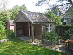 green backyard office repurposing a century old garage