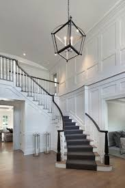 Define Foyer by Floor To Ceiling Recessed Paneling Graces The Spacious Two Story