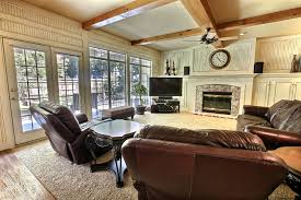 open plan living dining central fireplace summer retreat in