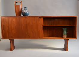 narrow teak sideboard or floating wall hung cabinet by bernhard