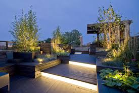 simple roof terrace design ideas with pattern wooden floor and red