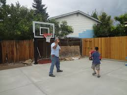 father and son time playing basketball in the backyard pro dunk