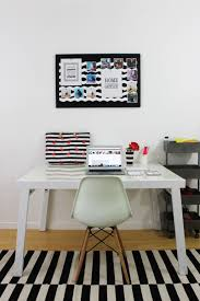 black and white home office lipgloss and crayons