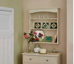 white wooden wall shelves with three racks on beige wall of