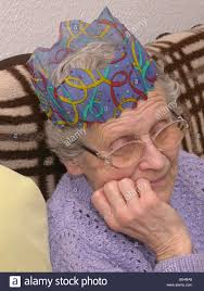 what to get an elderly woman for christmas elderly woman wearing a christmas party hat and looking fed up