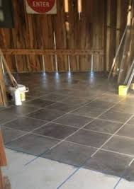 Tiling On Concrete Floor Basement by Diy Stain Your Concrete To Look Like Tile Garage Workshop