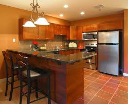 adorable burnt orange color resilient porcelain tile kitchen floor