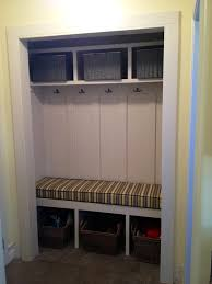 turn a closet into a mudroom complete with a storage bench