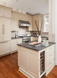 Cream Colored Kitchen Cabinets by O U0027brien Harris Amazing Ivory Kitchen Design With Cream Shaker