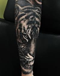 black and grey tiger on arm sleeve