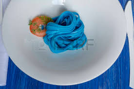 blue spaghetti black place setting pasta dyed with food