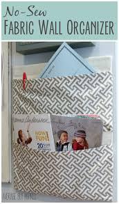 a diaper box becomes a no sew fabric wall organizer