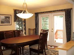 lighting over dining table two tone white and brown finish brown