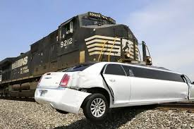 lamborghini limousine see train barrel into limousine stuck on the tracks