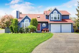 blue house white trim large blue house with white trim and a nice lawn stock image