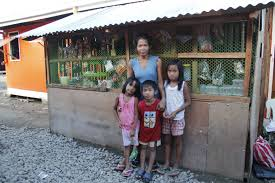 stories wfp united nations world food programme fighting noemi and her children in front of her store noemi s sari sari