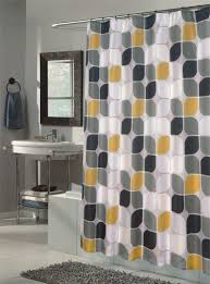 bathroom shower curtain with geometric pattern yellow white and