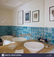 Mirror Wall Tiles by Contemporary Wash Basin In Front Of Mirror In Bathroom With