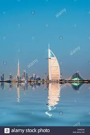 night skyline to luxury burj al arab hotel and city of dubai with