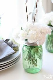 jar centerpiece ideas and easy jar centerpieces setting for four