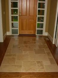 entryway tile with wood border tile wood woods and kitchens