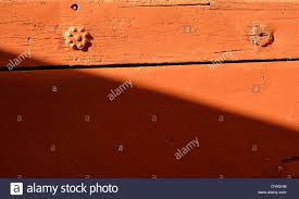 exterior red wooden door plank with decorate nails stock photo