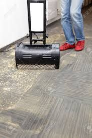 Laminate Floor Cleaner Machine Dry Cleaning Of Carpets With Powder And Machine Stock Photo